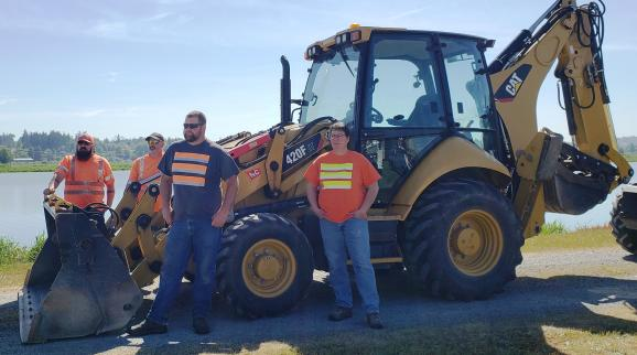 Employees Standing by Loader