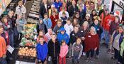 Aerial group photo of people gathered in Stanwood Camano Food Bank and Thrift Store
